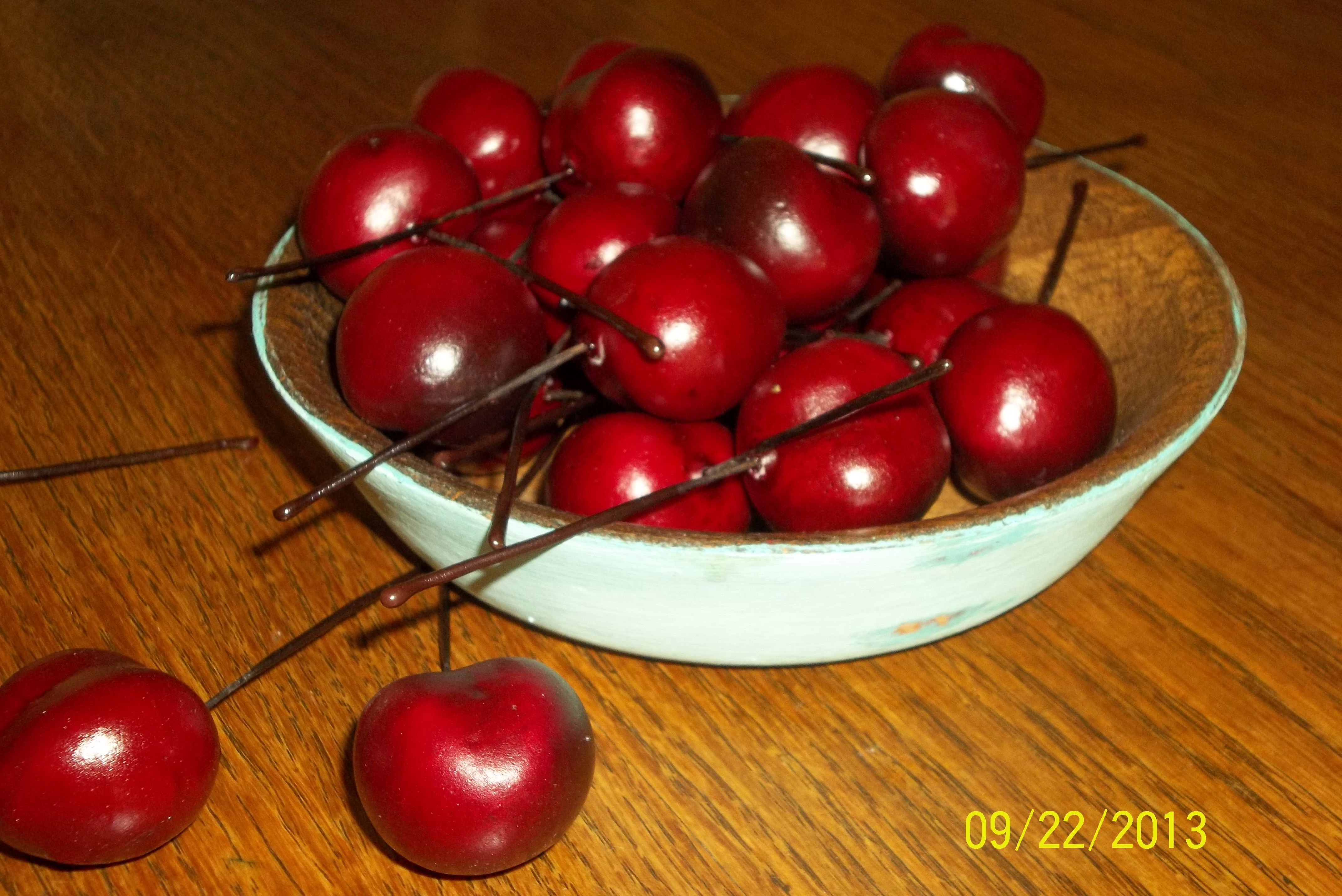Cherries in a painted wooden bowl
