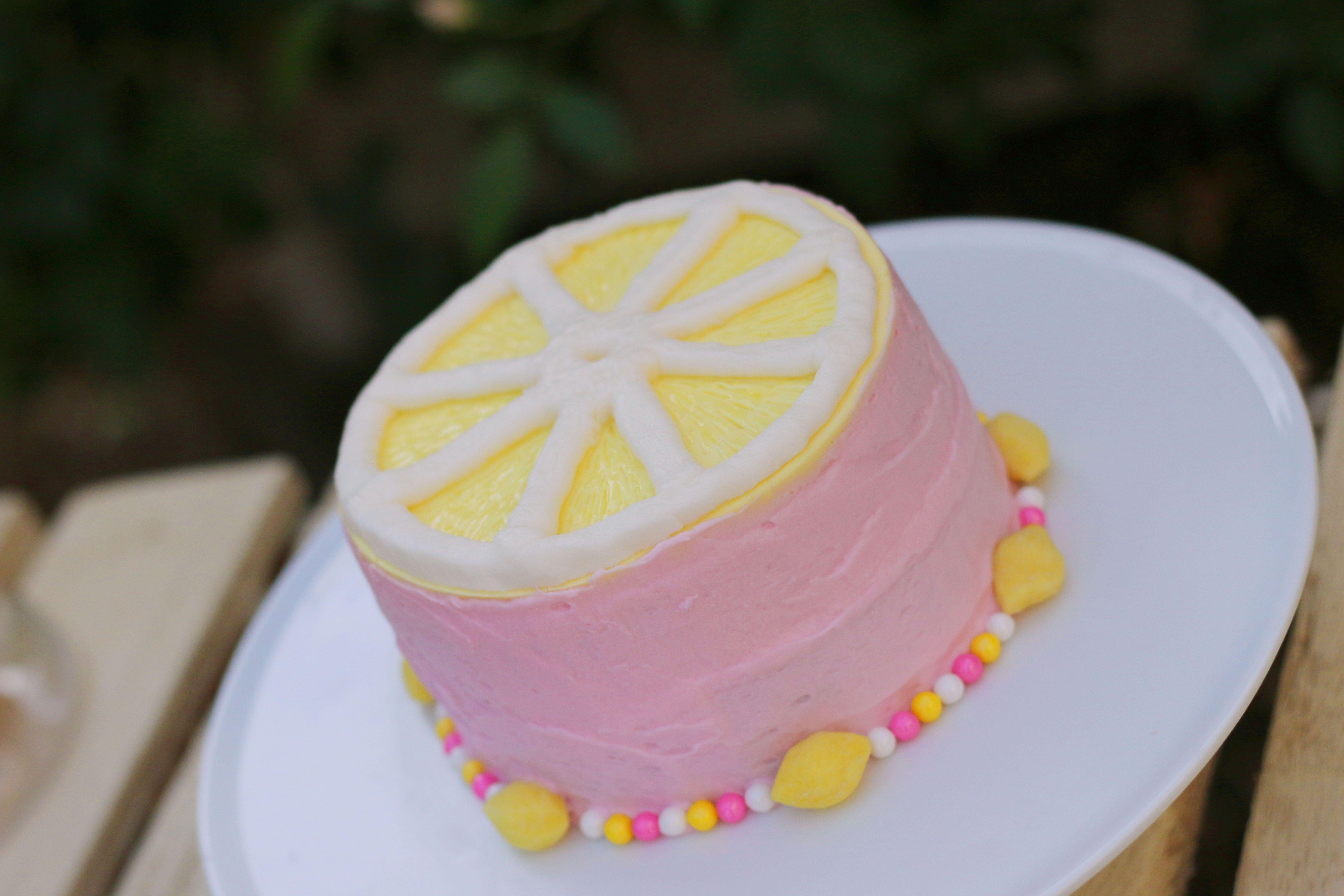 Lemon slice smash cake for pink lemonade first birthday party
