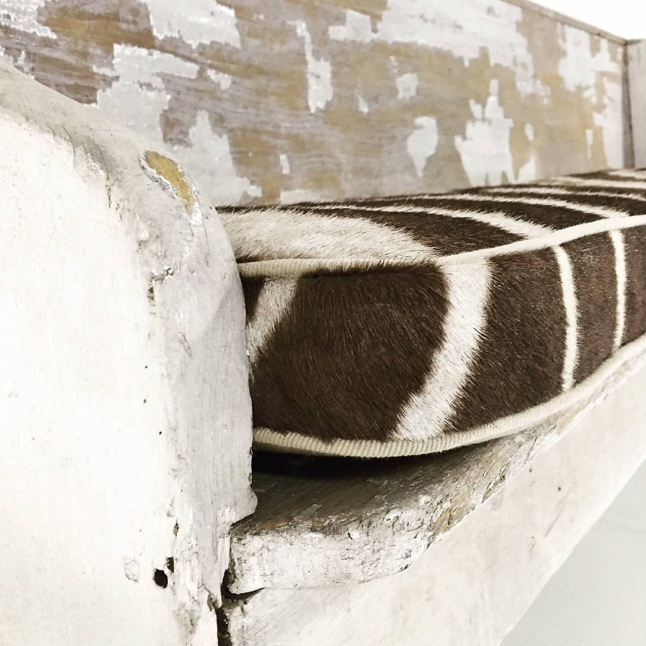 Early church pew with zebra hide cushion bench dining decor and