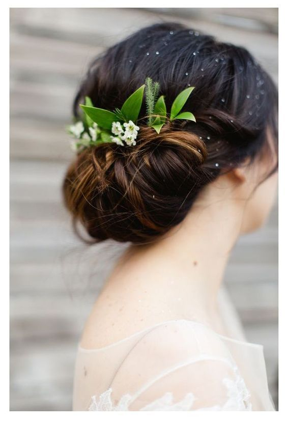 Splendid Wedding Hair Updo A Loose Low Bun With Flowers And Greenery Incorporating A Garden Feel Wedding Hair Flowers Wedding Hair Pictures Wedding Hairstyles