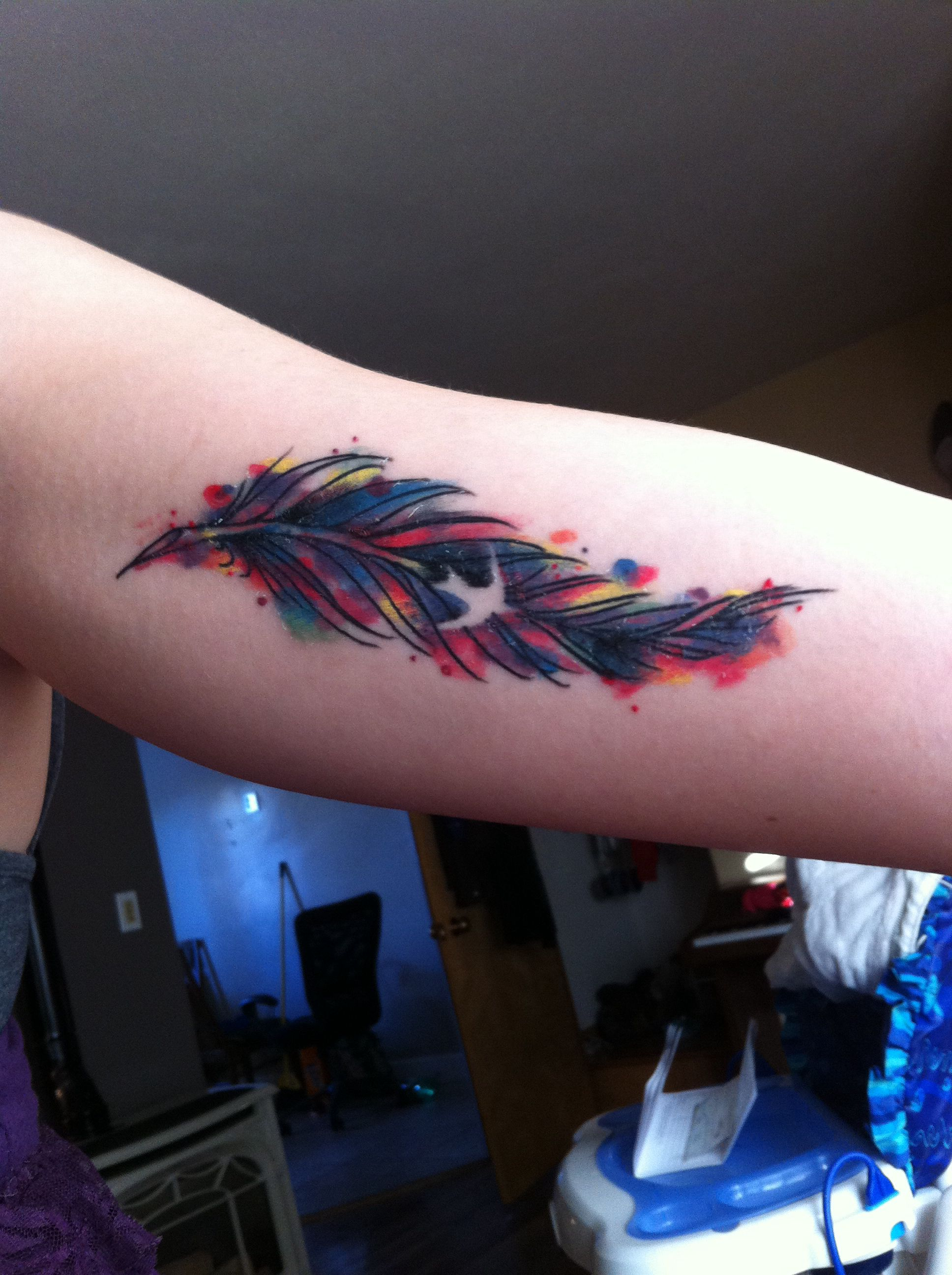 Watercolor feather tattoo my roommate got!