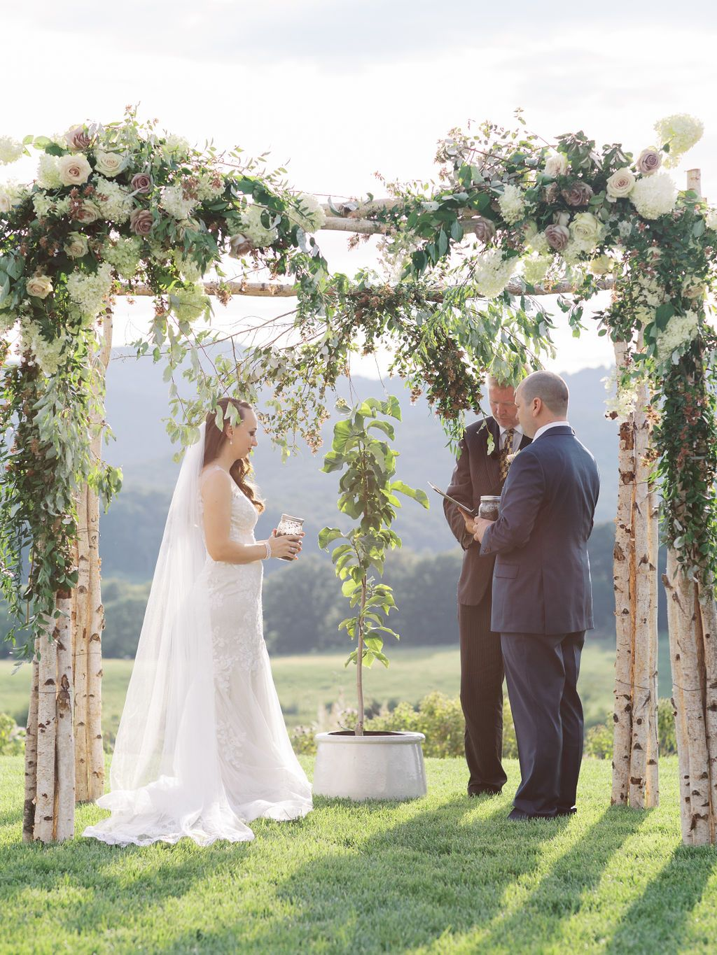 Floral arch accentuate a symbolic ceremony at Pippin Hill