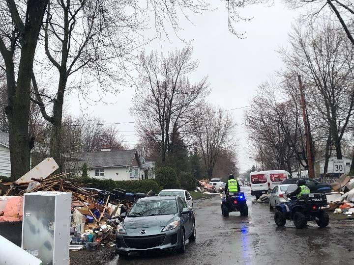 After heavy spring floods, demolition work begins in