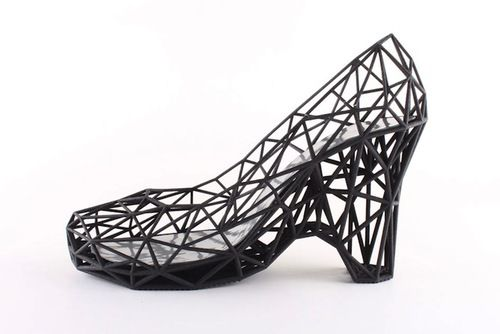 3D Printed Strvct Shoes.  Llned with a patent leather inner sole and coated with a synthetic rubber to provide greater traction.With 3D printed nylon, delicate looking forms are strong while also being lightweight.