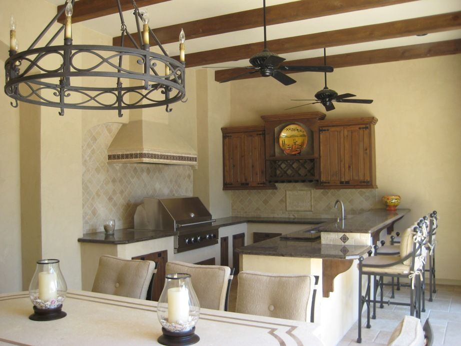 beautiful outdoor living space with stucco walls cedar beams and outdoor kitchen with images on outdoor kitchen and living space id=19018