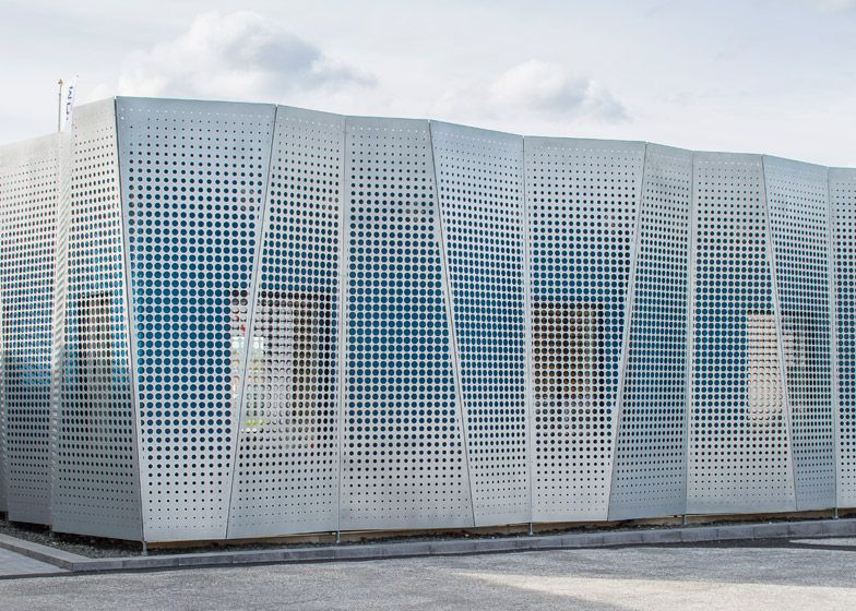 Perforated Metal Covers The Facade Of This Office