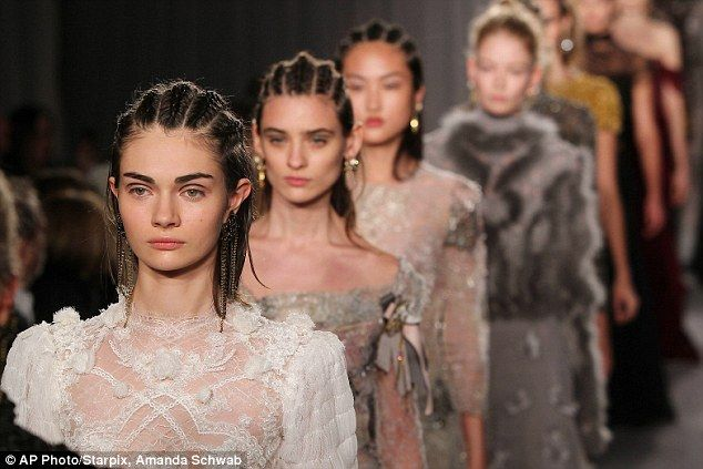 Hip-hop hair: Many of the catwalkers had their hair styled in corn-rows - an eccentric choice - while clad in the ethereal frocks