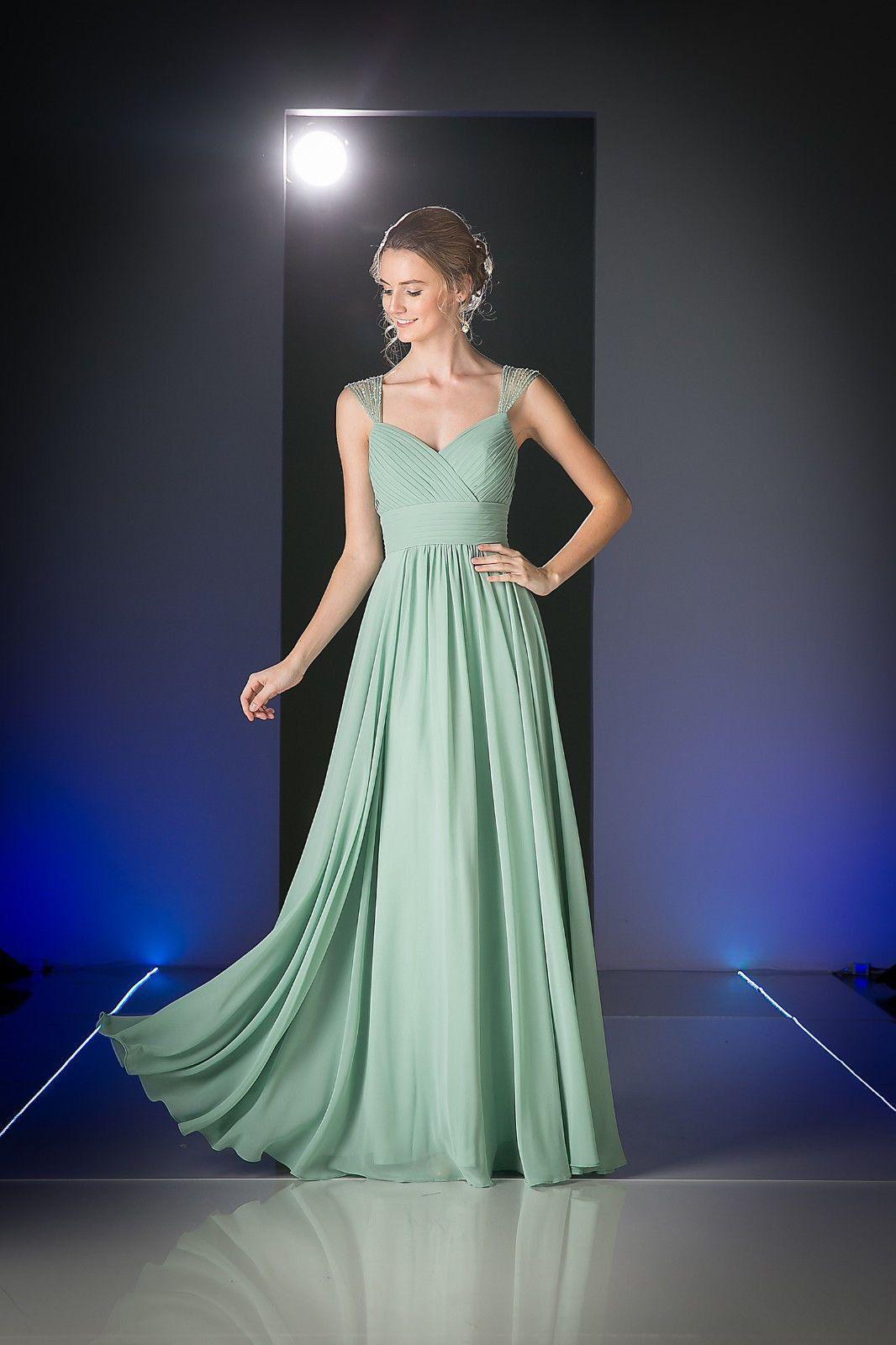 An elegant simple long bridesmaid dress features beaded sheer cap
