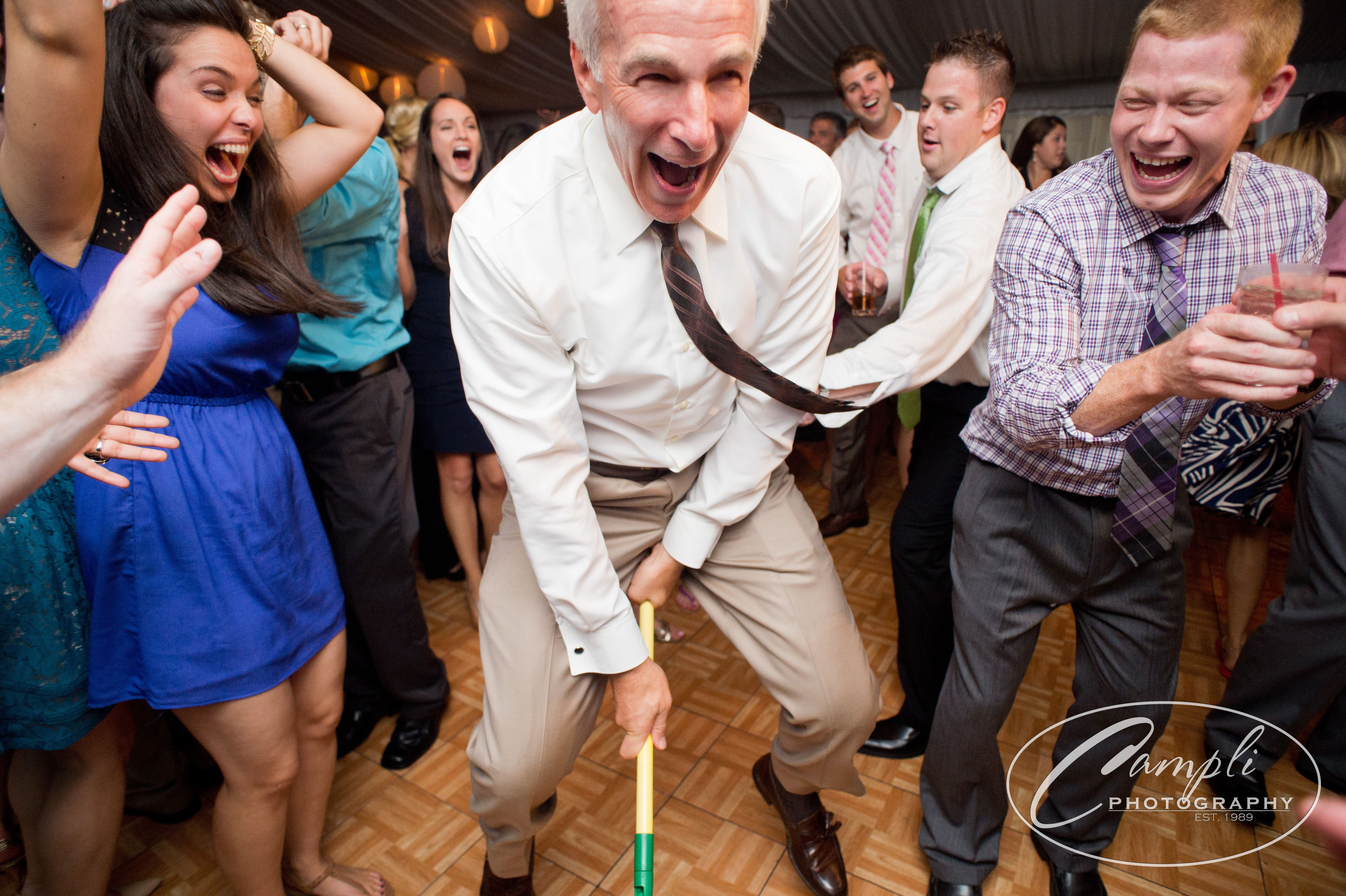 Brides Father Having A Great Time Dancing At The Reception At