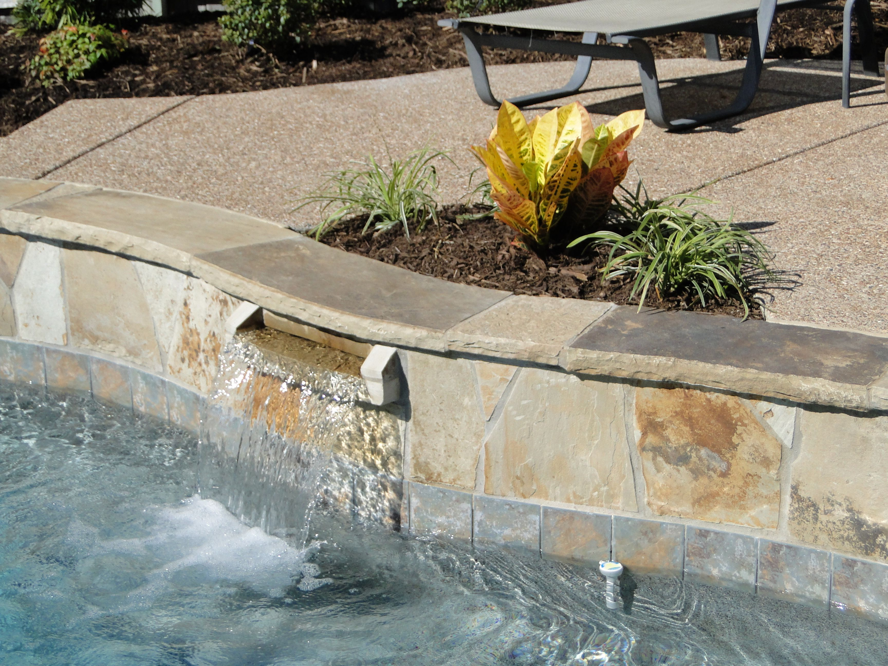 Stone scupper | Pool designs, Outdoor, Water features
