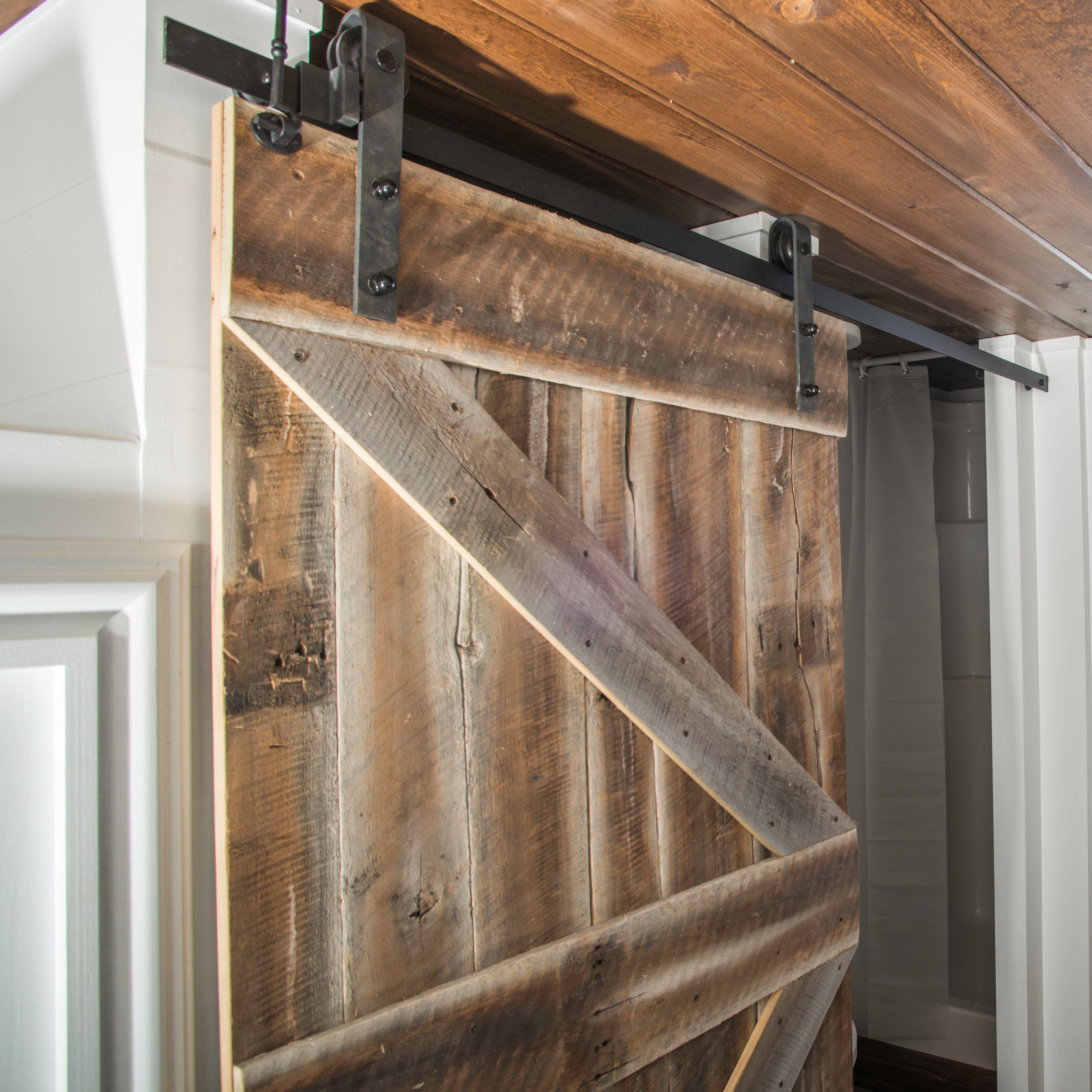 Reclaimed wood barn door made by 84 lumber custom for Custom barn doors