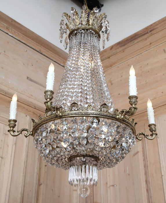 Neoclassical inspired chandelier Boasting an intricately cast brass