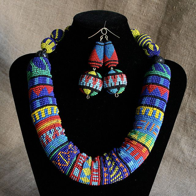 """Gutta Perca's square stitch earrings and necklace """"Birds of the New World"""""""