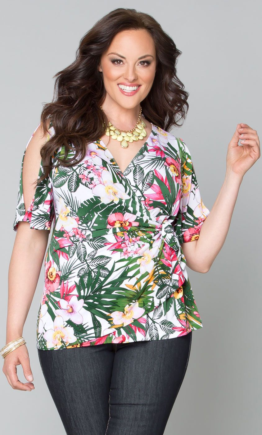 Feel like you're on a tropical vacation in our plus size Wanderlust Wrap Top.  www.kiyonna.com  #KiyonnaPlusYou  #Plussize  #MadeintheUSA  #Kiyonna  #floral