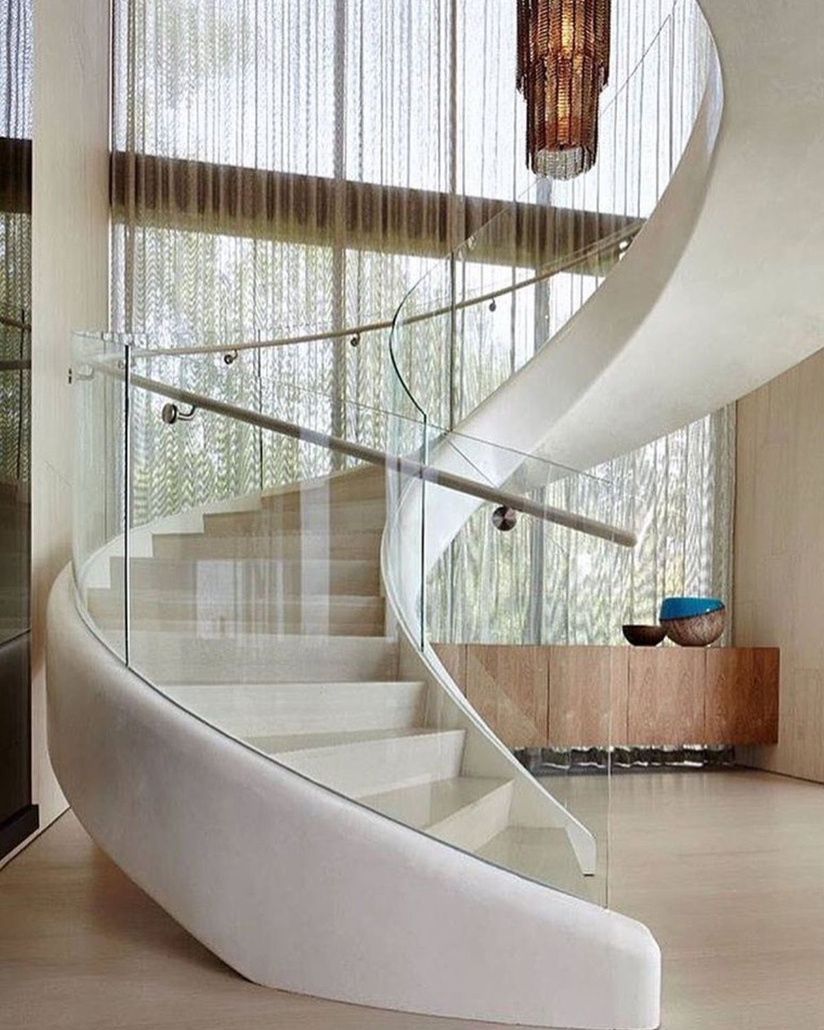 This White Sculptural Spiral Staircase Entices You Upstairs In This Home.