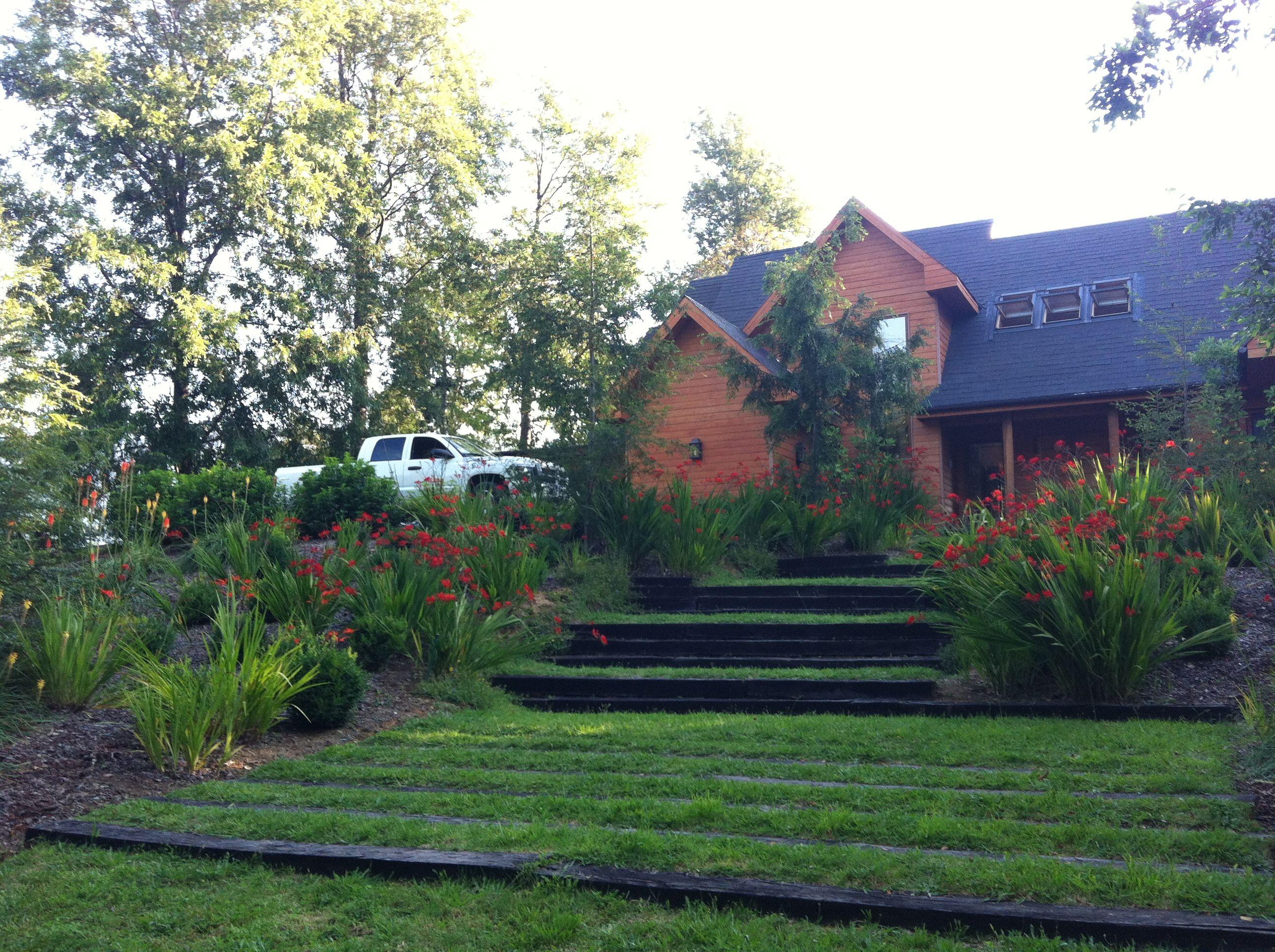 Casa calafquen sur de chile grupo alerce paisajismo for Paisajismo jardines casas