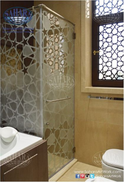 Beautiful frameless shower glass with islamic sandblasted for Bathroom design uae