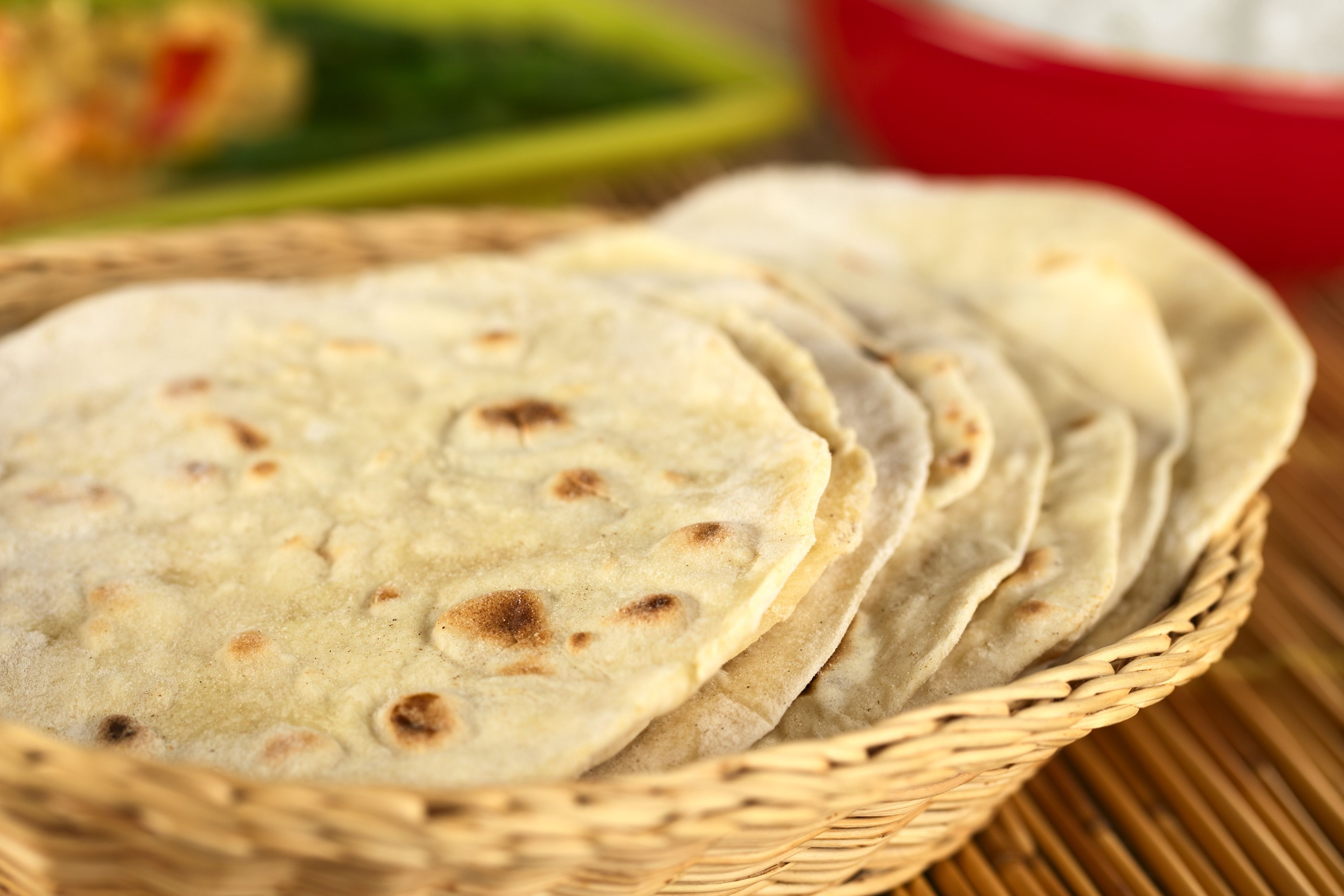 11735834 - indian flatbread called chapati in basket (selective focus, focus on the big brown spot on the front of the first chapati)