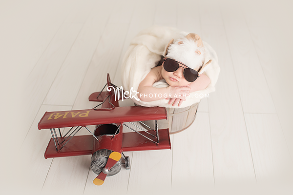 Isaiah newborn session airplane prop glasses prop simple set up melzphotography