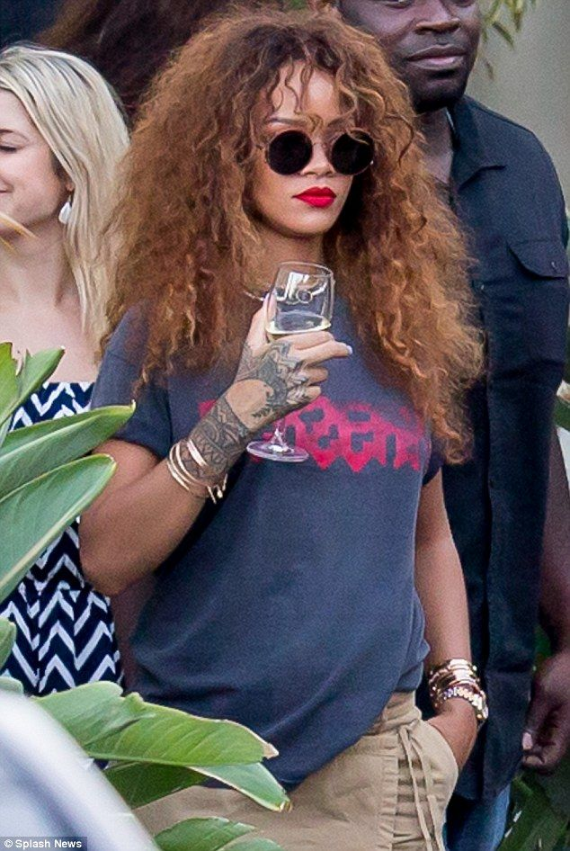 4666494cf6 Rihanna downs a glass of wine during a lunch date in Malibu