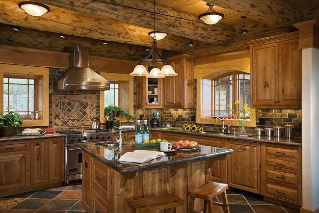 This open floor plan has a large kitchen with many windows and cabinets for storage - See more at: http://www.thehousedesigners.com/plan/ultimate-log-home-9436/#sthash.fnyk85Pw.dpuf #LogHomeDecorating