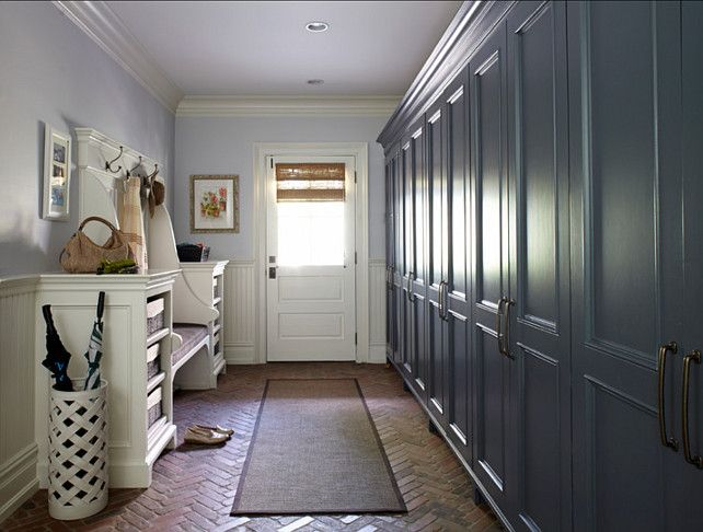 Wall Of Mudroom Storage Brick Floors