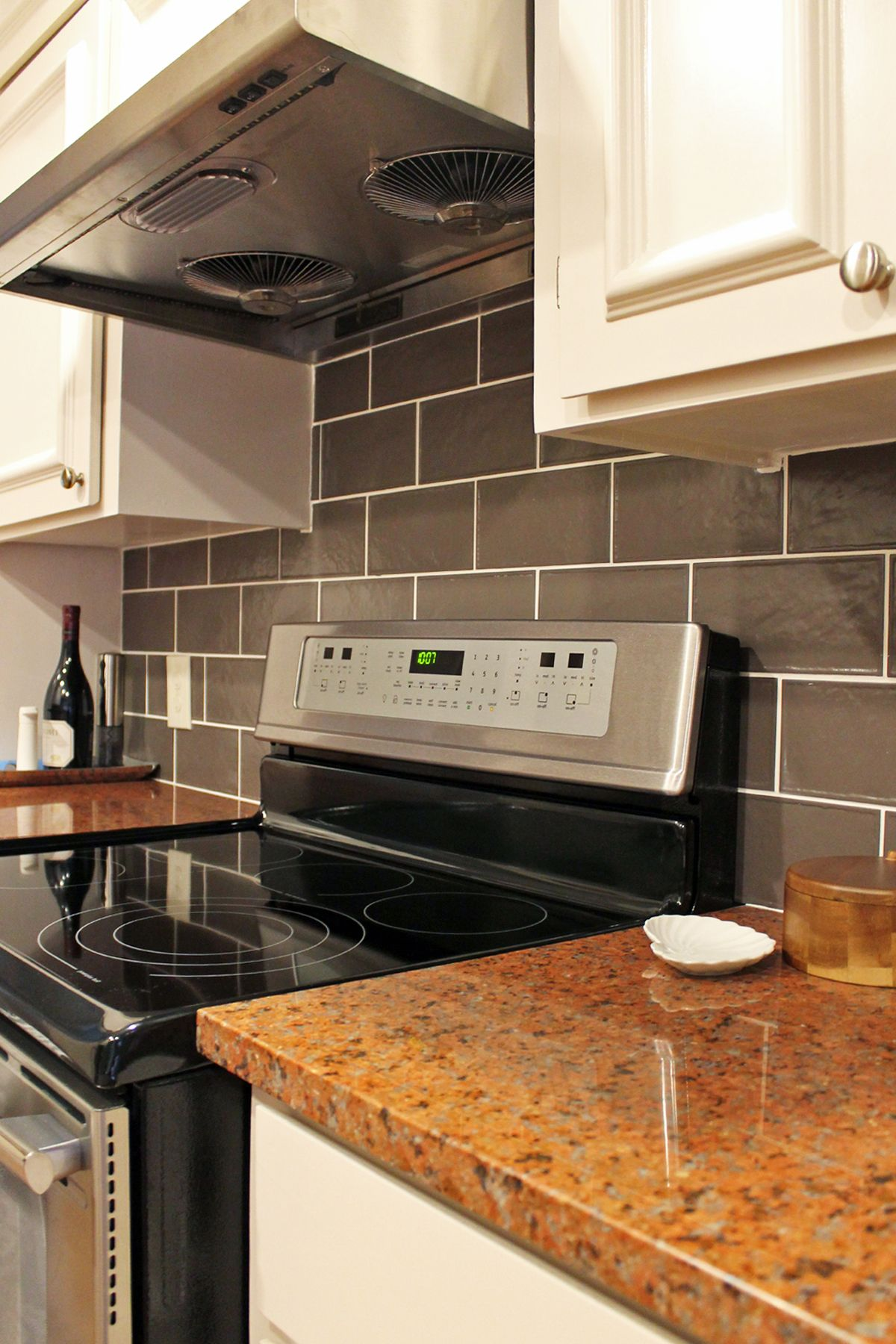 Contemporary #kitchen With Red Granite Countertops And Gray Subway #tile  Backsplash.