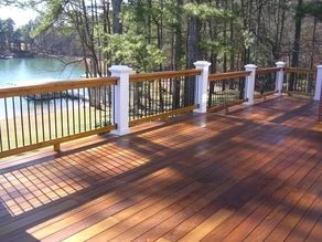 Pretty White Posts On Wood Stained Deck With Images Staining