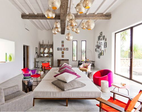 intriguing room! love the oversized center bench/lounge and the neutral with pops of neon. oh and the lighting very cool too...