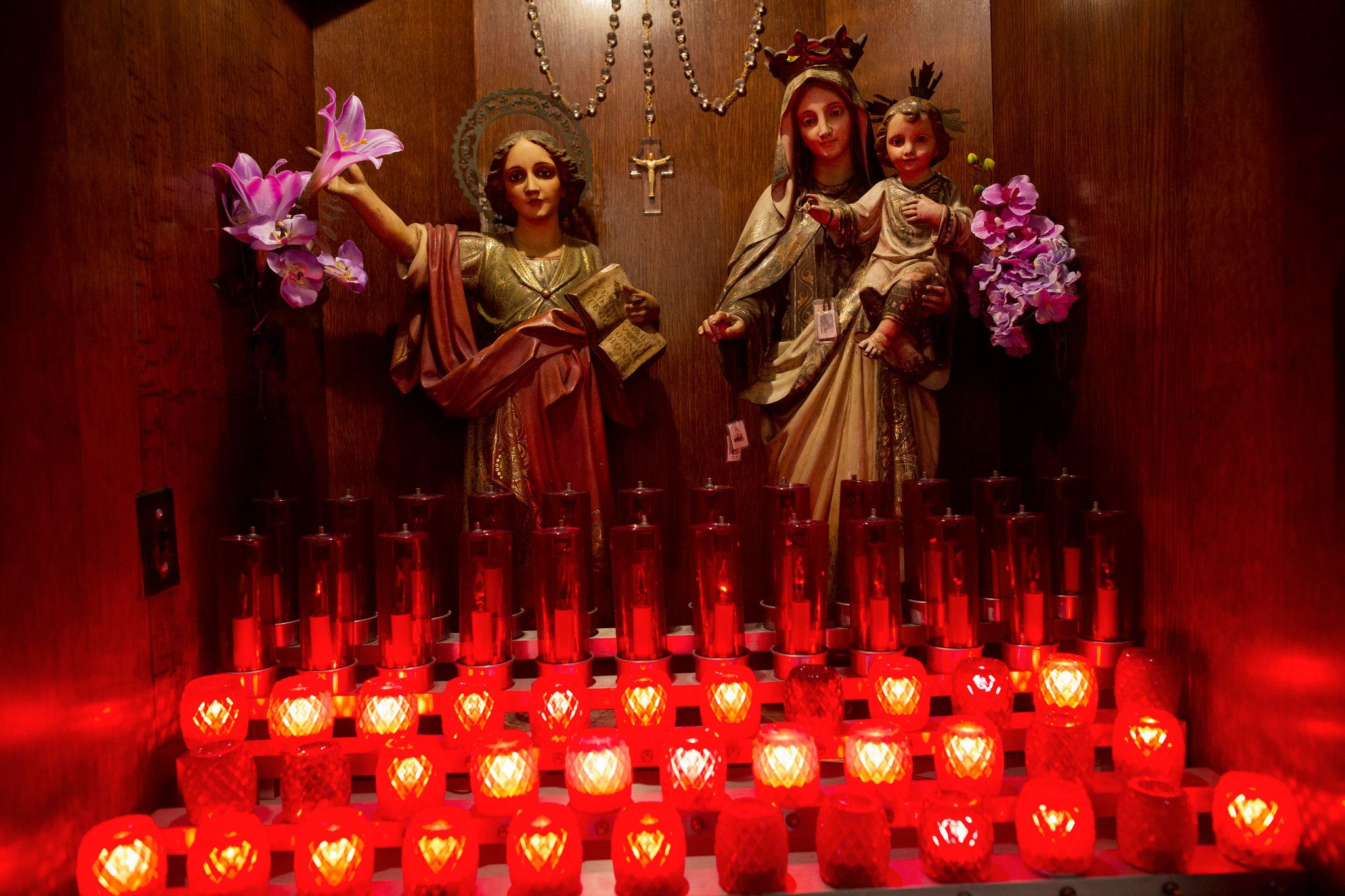 Heartache for New York's Catholics as Church Closings Are Announced - NYTimes.com. Religious statues adorn an alcove at the Church of the Holy Agony during morning Mass in Harlem. During the service, congregants learned that their parish would be merged. Victor J. Blue for The New York Times