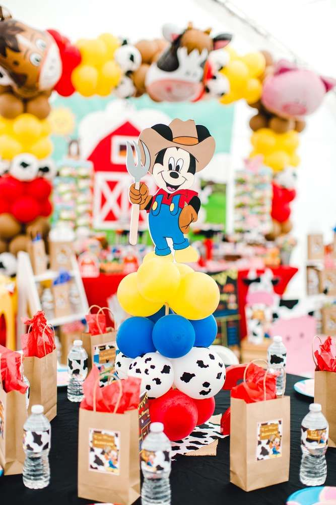 Loving the centerpiece at this Mickey Mouse Barnyard themed Birthday Party! See more party ideas and share yours at CatchMyParty.com  #catchmyparty #partyideas #mickeymouseparty #mickeymousefarmparty  #farmparty #mickeymousefarmcenterpiece #mickeymousefarmpartydecorations #mickeymousebirthdaypartyideas1st