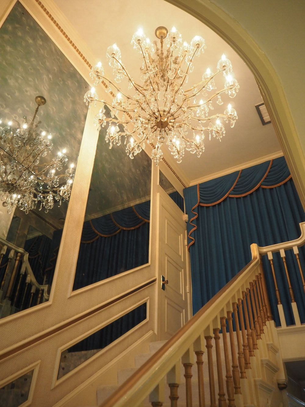 A Beautiful Chandelier Hanging Over The Grand Staircase At Graceland {elvis  Presley's Home, In