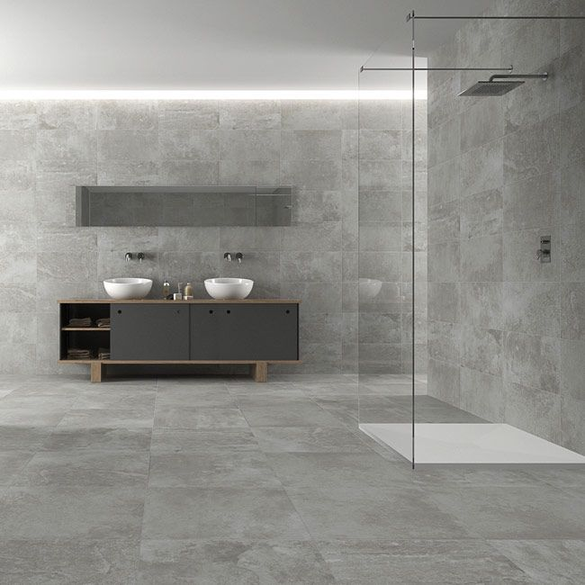 If You Re Investing In A Contemporary Wetroom Grey Porcelain Tiles Are An Ideal Choice As You Can Use Gray Bathroom Decor Concrete Bathroom Black Floor Tiles