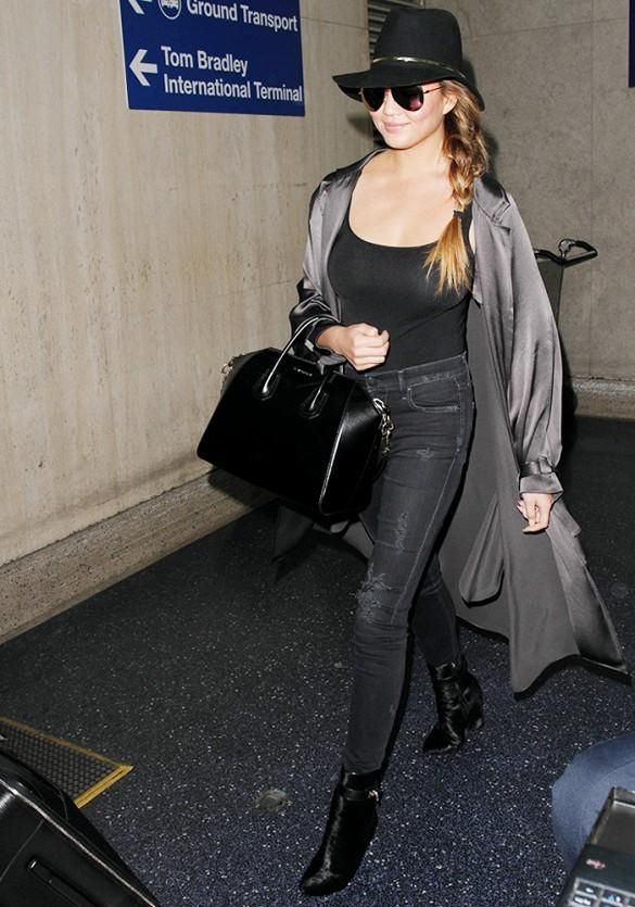 Who else can rock a satin trench coat like Chrissy Teigen?