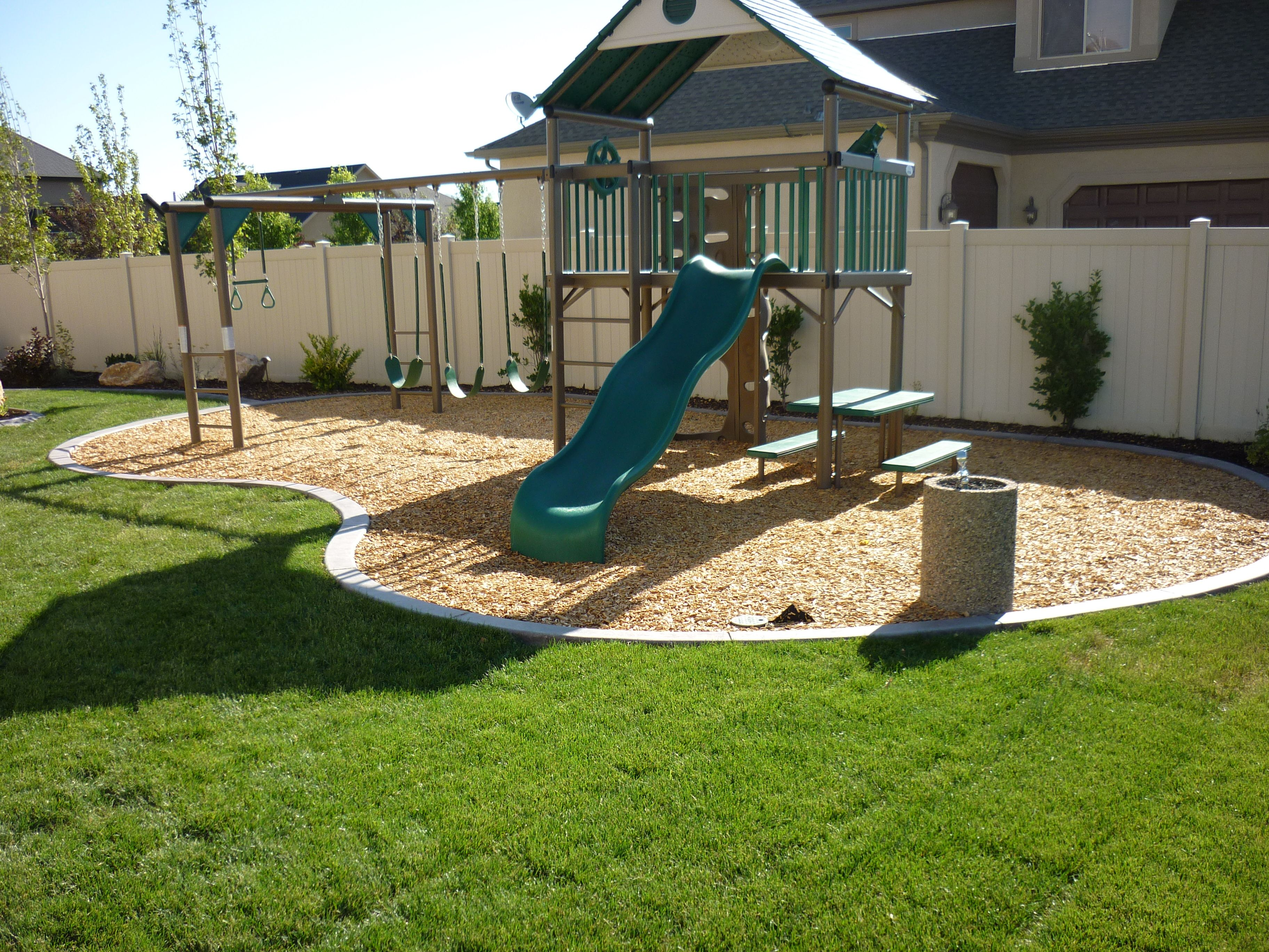 Backyard playground in the landscaping in South Jordan ...