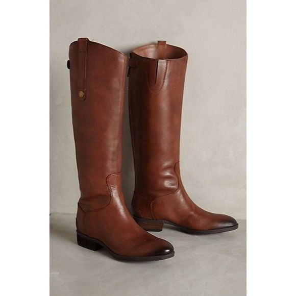 Sam Edelman Penny Boot Color is Whiskey. Size 7M Back-zip closure with snap tap at shaft. Leather upper with asymmetrical collar. Man-made lining. Lightly cushioned man-made footbed. Stacked heel. Man-made sole. Imported. Sam Edelman Shoes Winter & Rain Boots