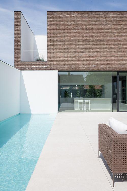 Kijkwoning - AR+#1  casa branca e tijolos vista a partir da raia olimpica
