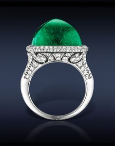 Cabochon Colombian Emerald Ring, Featuring: Gubelin Certified 21.97 Ct Cabochon Colombian Emerald (Center Stone) Surrounded by 1.19 Ct Pave' Set White Diamonds. Mounted in Platinum.