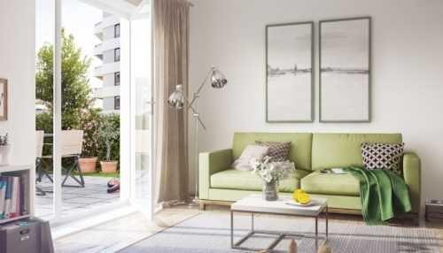 Moderne Einrichtung mit grünem Sofa im Wohnbereich