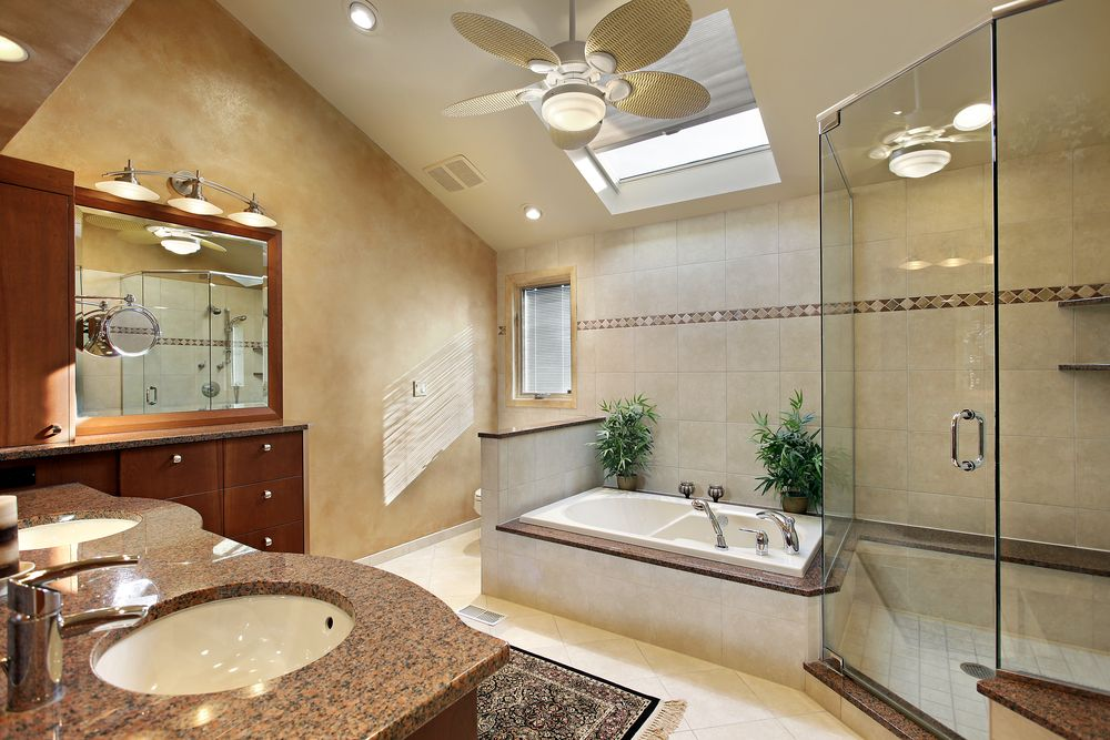 Vaulted Ceiling Bathroom With Skylight Over The Tub And Separate Glass  Shower