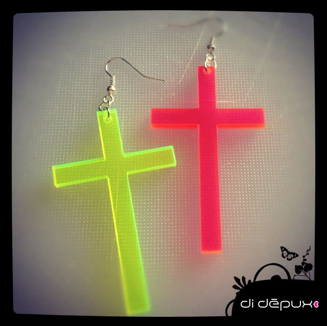 Big cross earing (neon pink or neon yellow) one item. €5.00, via Etsy.