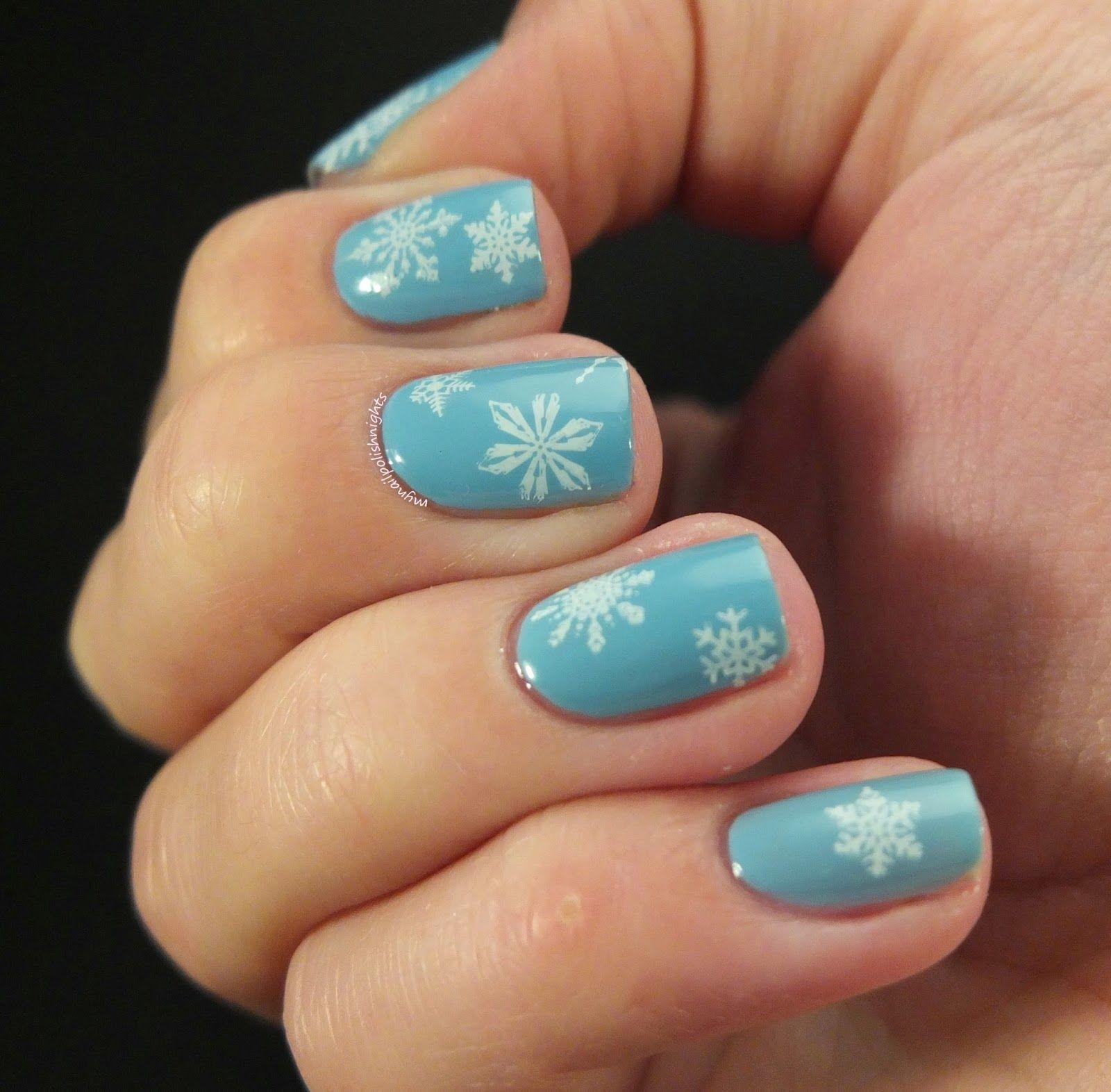 Light blue white snowflake stamping nails http