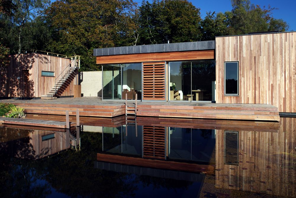 Fresh Water Swimming Pond, Boardmarked Concrete Wall, IPE Cladding, Contemporary  House | The
