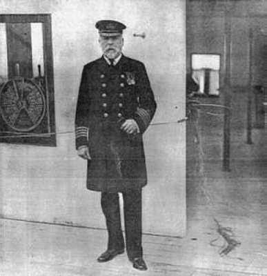 Captain Smith photographed by a newspaper photographer on the bridge of the Titanic. Southampton, April 1912. A Engine Telegraph is visible in the background.