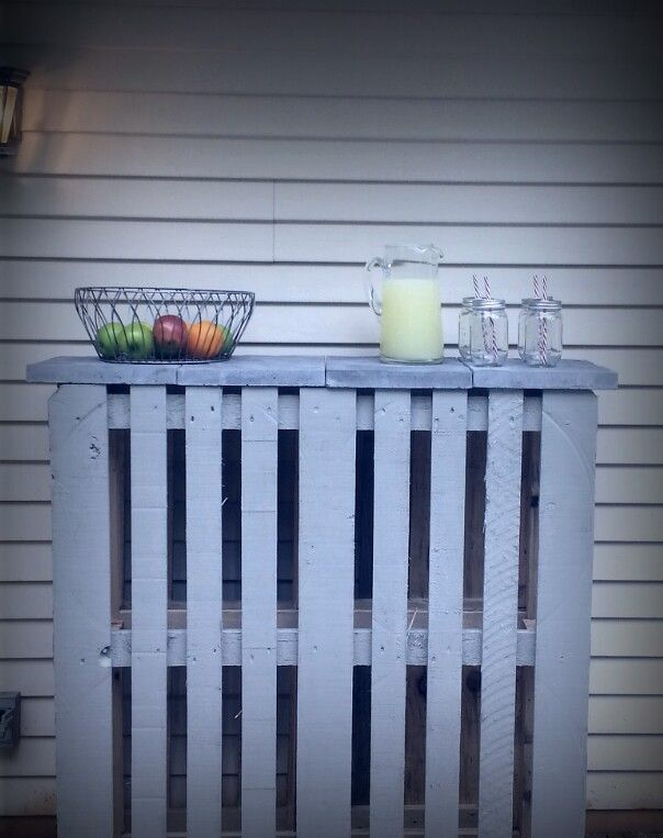 """Did it! DIY $9 pallet patio bar.  Two pallets back to back (free), nailed together, painted with 4 pavers (just over $2 each from Home Depot.)  Painted with an """"oops"""" deck paint."""