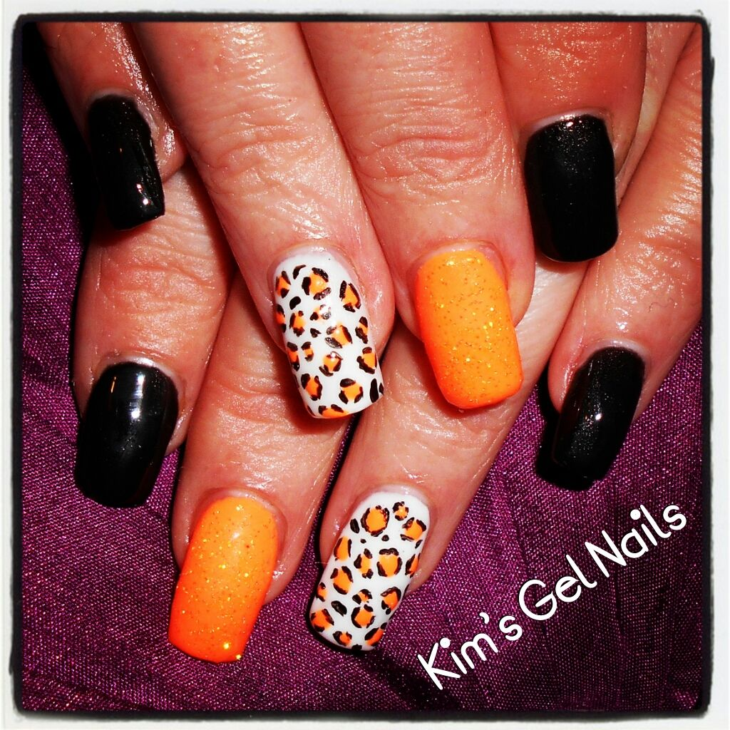 Black, white and orange square gel nails with leopard print hand ...