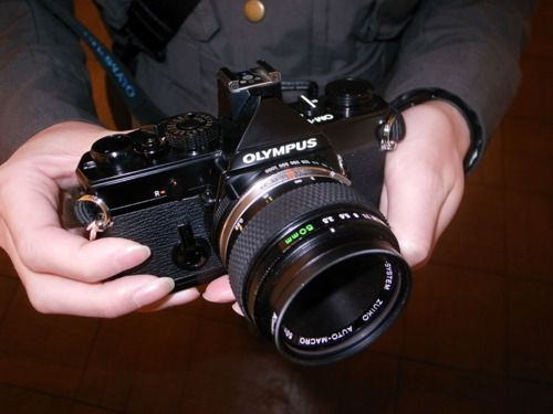 Olympus OM-1 with 50mm lens. My all time favorite camera. I still have her.