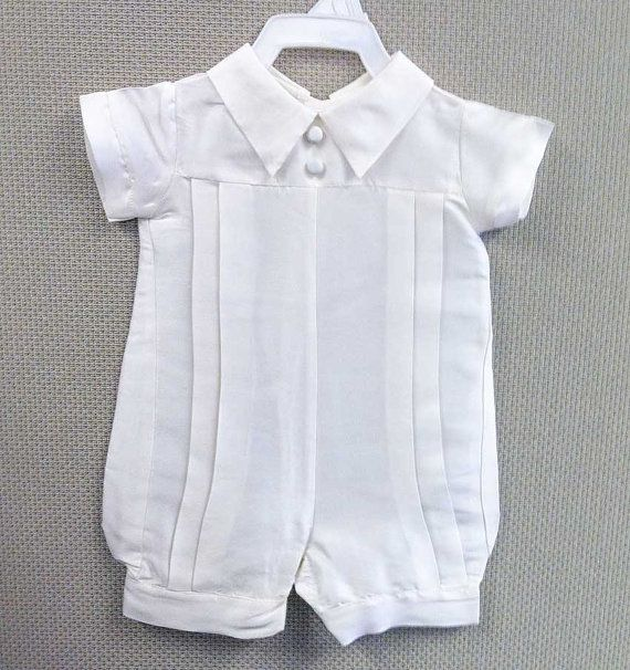 This luxurious silk dupioni christening romper in a finely detailed with pleats and a pointed collar. It has been discounted in order to make room for new designs, also because some have minor flaws and/or missing the bonnet or decorative buttons on the front. Now is your chance to get an exclusive design made in the USA at a discounted price. Full description below.  Ready to ship in 1-2 business days (Monday - Friday) *Please see shipping tab for delivery times*  Order size according t...