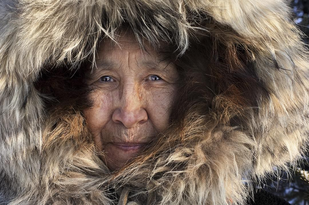"""Photo by @alisonwrightphoto // Jean Stevens native Eskimo woman in Bettles Arctic Circle Alaska.  I was photographing a story on the coldest places on the planet Bettles being one of them. It was so cold my eyelashes actually froze. The northern light show was breathtaking but living here is not for the faint of heart. Jean at 77-years-old still runs the local post office and tears around on her snowmobile delivering the mail.  This image is featured in my book """"Face to Face: Portraits of…"""