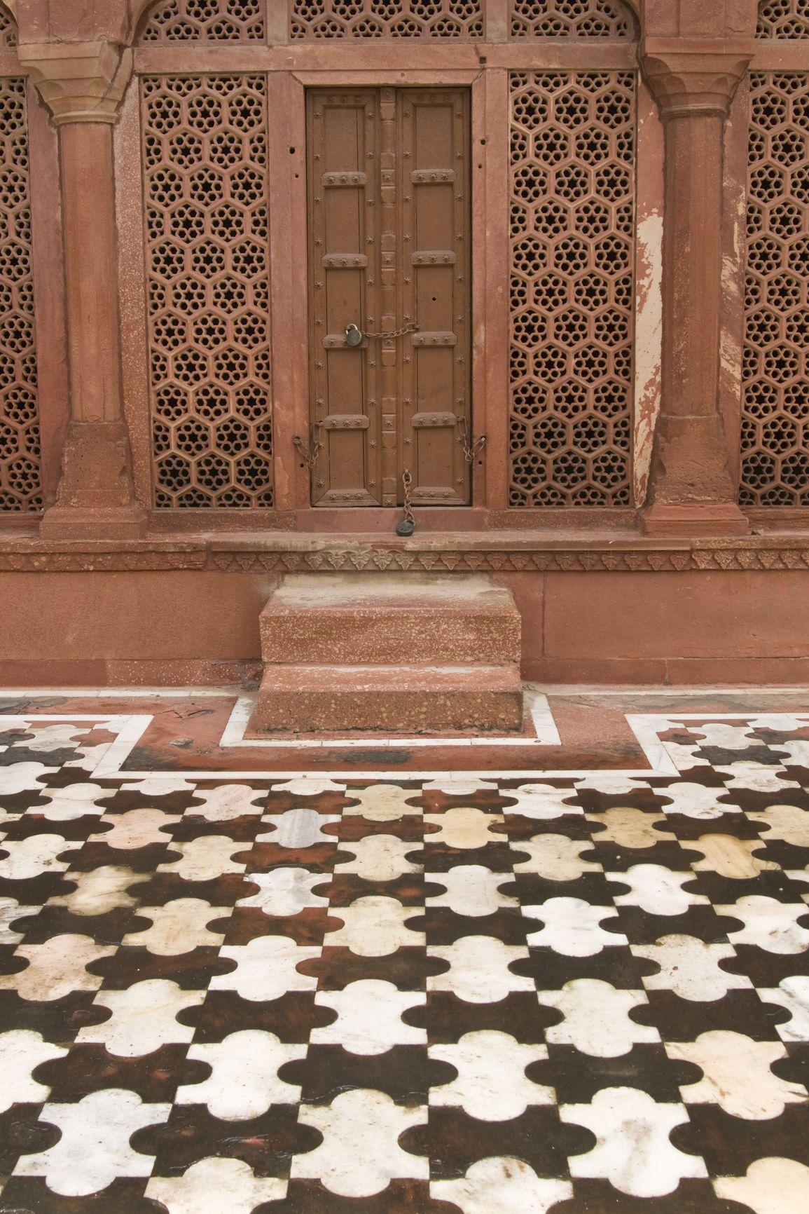 Taj Mahal. Detail of red sandstone doorway and patterned